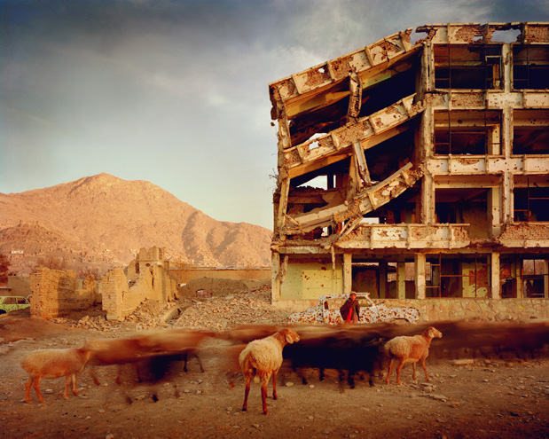 Bullet-scarred apartment building and shops in the Karte Char district of Kabul. This area saw fighting between Hikmetyar and Rabbani and then Rabbani and Hazaras.